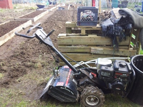 The rototiller and an early version of my compost bin. These pallets were taken away to underlay a wood pile later in the season.